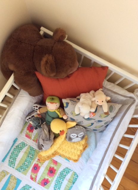 The craigslisted crib, a few Etsy pillows, a hand knit ducky lovey, and a few other precious bedtime companions.