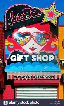 a-colorful-sign-for-the-lola-star-gift-shop-on-the-boardwalk-in-coney-DK6AFF