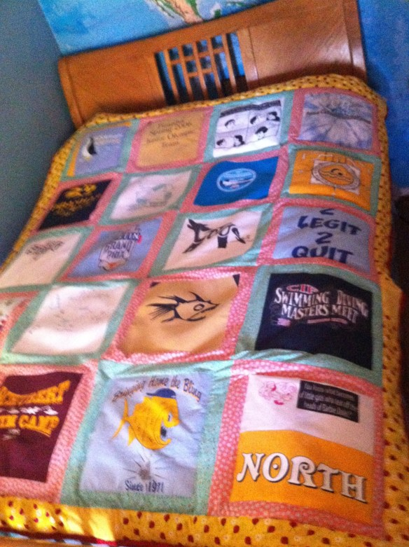 The swim tee shirt quilt I made for my daughter's dorm room. Years of memories.