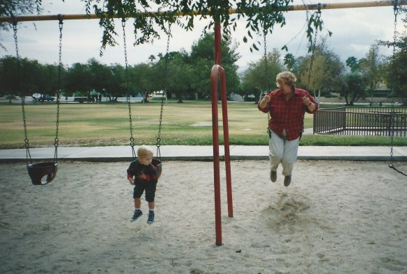 Grandma on the swings with Robert.
