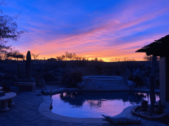 Sunrise colors over swimming pool