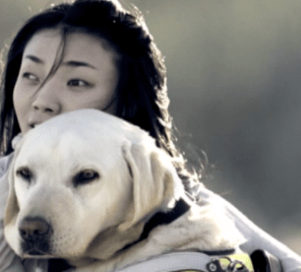 Yeaji and her guide dog, Chan Mi.