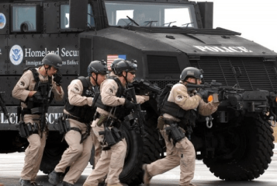 DHS Agents With an Mine-Resistant Ambush-Protected (MRAP) Armored Personnel Carrier
