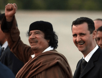 Libyan dictator Colonel Muammar al-Gaddafi with Syrian dictator President Bashar al-Assad, both responsible for executing tens of thousands of their own citizens