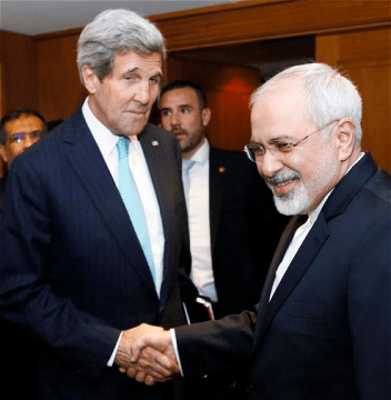 U.S. Secretary of State John Kerry shakes hands with Iranian Foreign Minister Mohammad Javad Zarif who seems to be finding something humorous which Kerry has missed completely