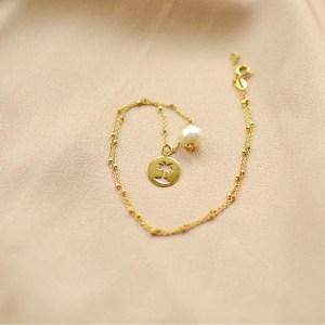collar de palmera y perla-blingbling