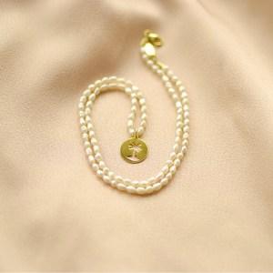 collar de perlas y palmera-blingbling