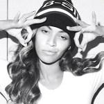 Beyonce' black and white photo wearing white tee.