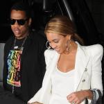 Beyonce' pairs a white tee shirt with white blazer.