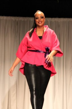 Plus size model Desiree Scott rocking the runway at Kiss the Curves.