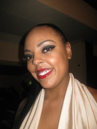 Plus size model Desiree wearing Black Opal Patent Lips in Red Intensity lipgloss for Kiss the Curves