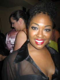 Plus size model Tenika Blue wearing Black Opal Red Patent Lips for Kiss the Curves