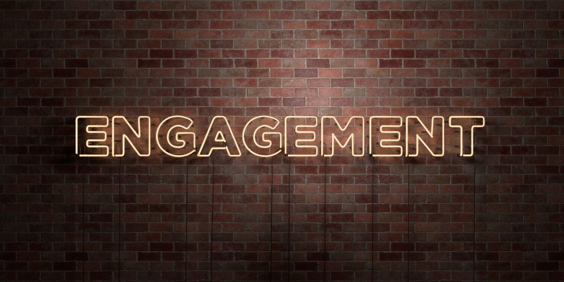 ENGAGEMENT - fluorescent Neon tube Sign on brickwork - Front view - 3D rendered royalty free stock picture. Can be used for online banner ads and direct mailers.