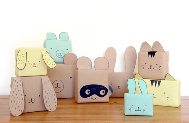 กล่องห่อกระดาษและวาดตาและเติมหูเป็นหน้าสัตว์ต่างๆ