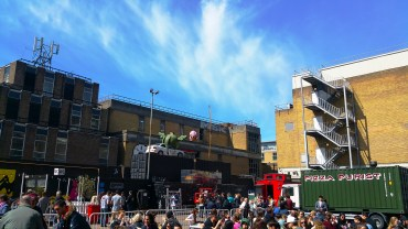 An area near the Brick Lane Street Market with people enjoying the sun, food, music and more.