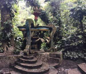 Cement artwork that resembles a fountain, surround by the jungle at Las Pozas.