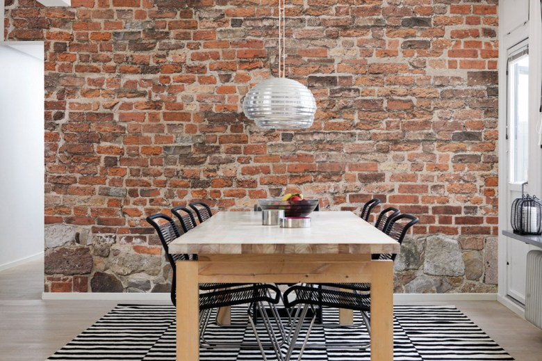 Dining table in a room with D.Tales brick effect on wall