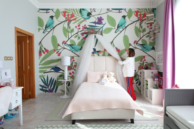 Interior Designer Gabby Garven shows off child's bedroom design with bird wallpaper and tulle drape over the bed