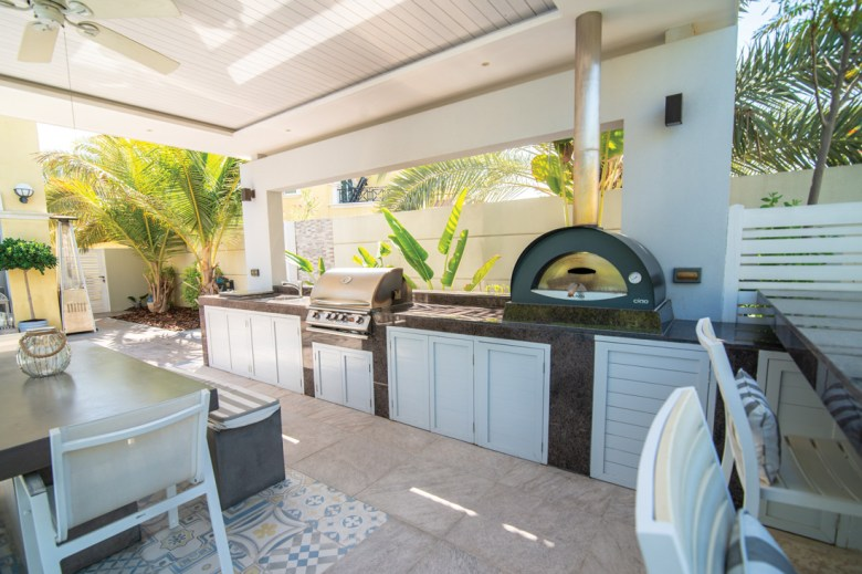 Backyard kitchen, grill and dining area
