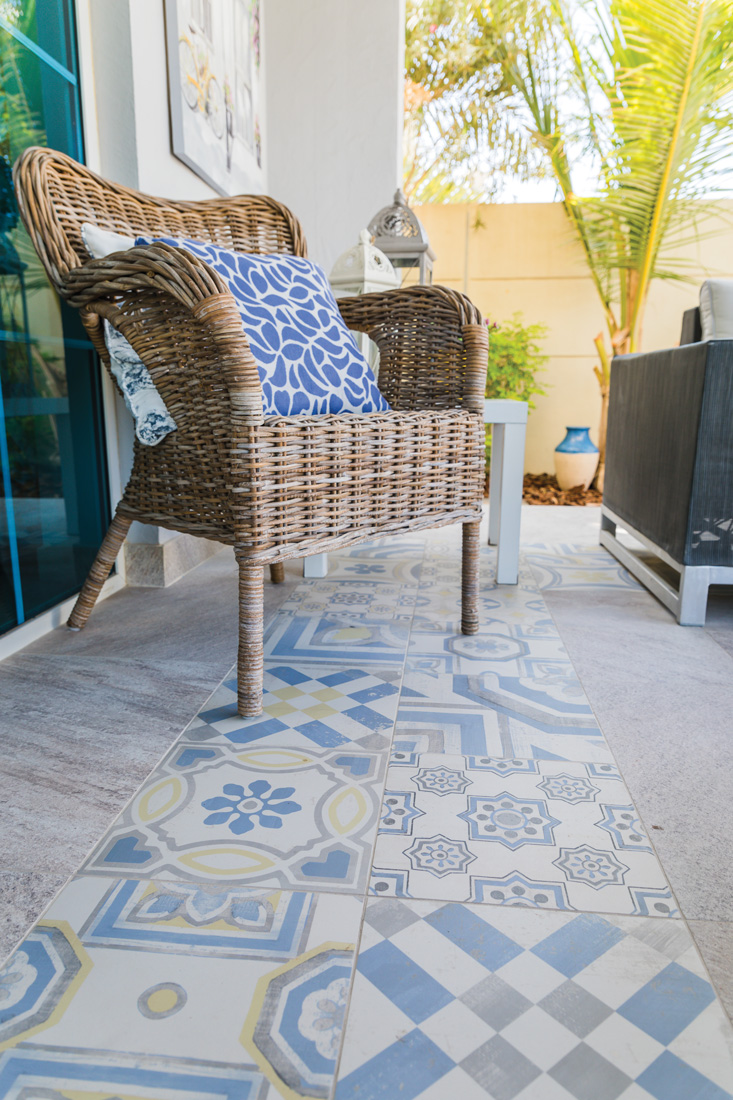 Wicker chair on top of floor tiles from Italy