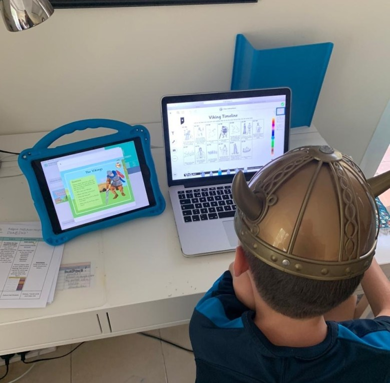 A child learns at home via his laptop distance learning in the UAE