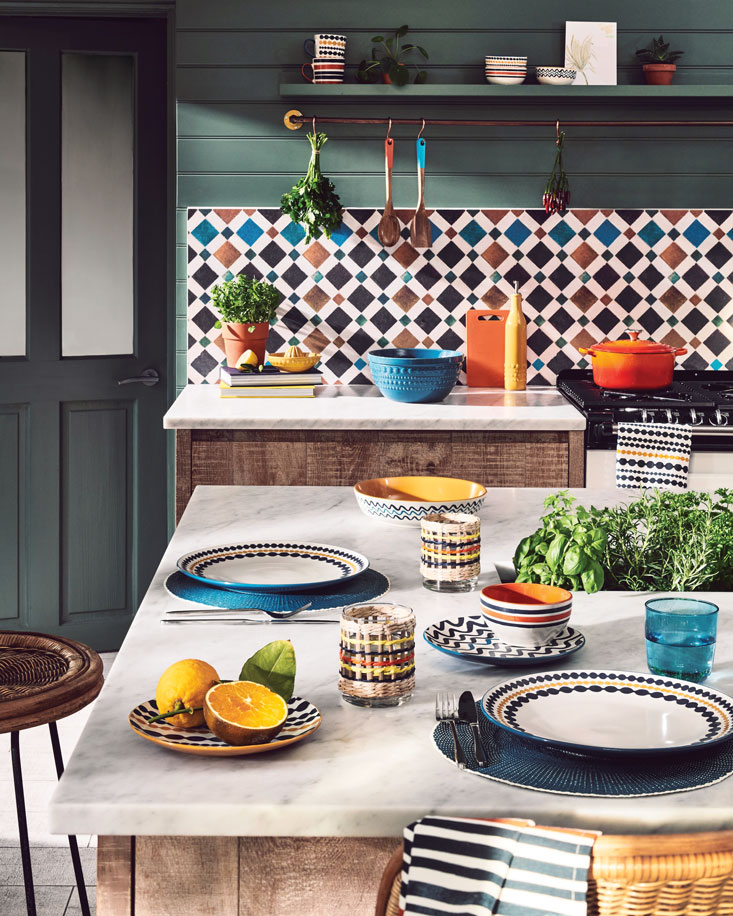 Patterned kitchen tiles with table set up in bold colours