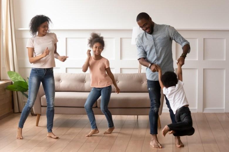 family dancing living room