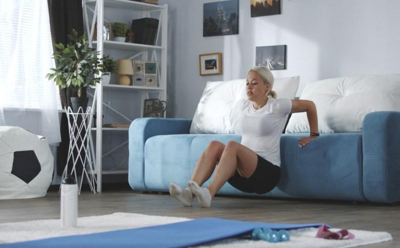 tricep curl woman sofa