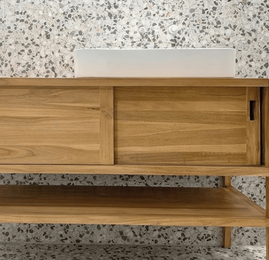 Timber cabinet over terrazzo floor and wall tiles