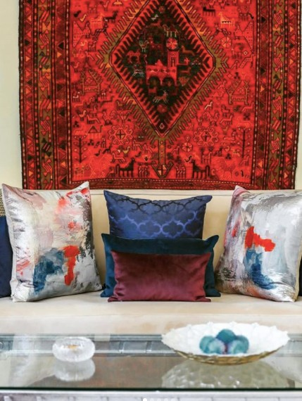 rug on wall and throw cushions sopranda interior_designer_dubai