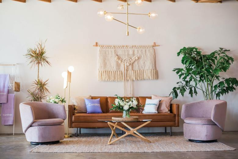 Bohemian style living room with pink  armchairs
