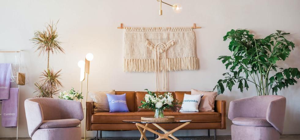 A boho style living room with leather sofa