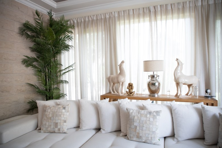 White sofa with white curtains in Kenza Bekri's home