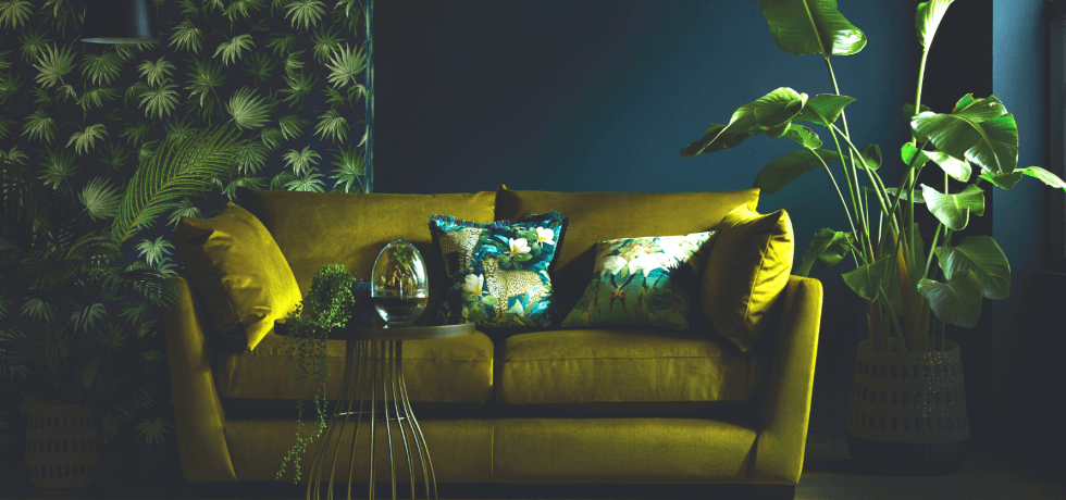 Green sofa with floral wallpaper