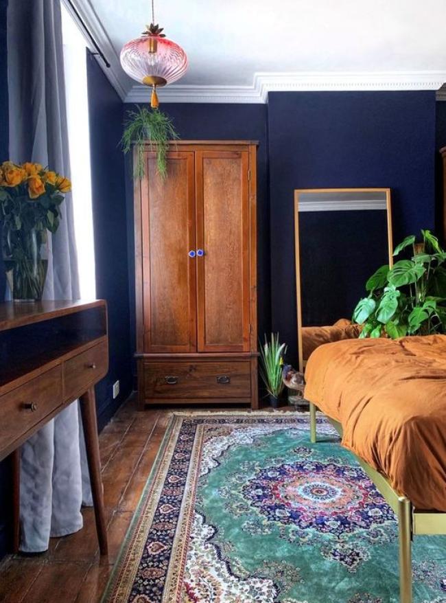 Dark blue wall bedroom