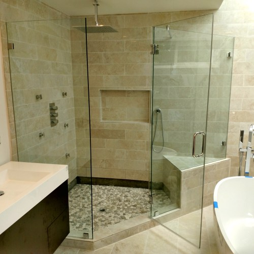 Inline Glass to Glass Custom with Notch Panel by Blizzard Frameless Showers