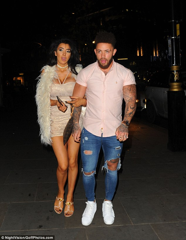 Scanty outfit: Celebrity Big Brother star Chloe displayed her surgically enhanced cleavage in a plunging nude dress