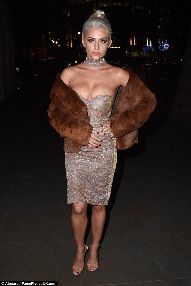 Glitter girl: X Factor alumChloe Paige, 22, wore a golden strapless dress