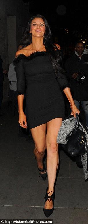 Monochrome maven: The former stripper and pole dancer wore a black Bardot dress with a fur trim
