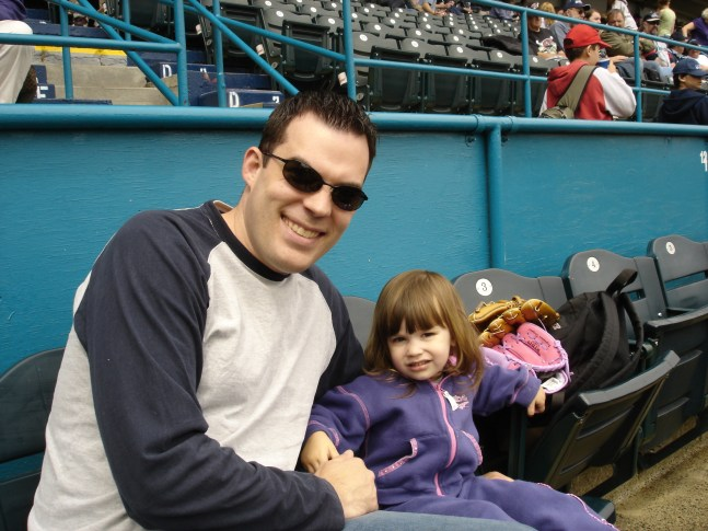"""Megan's first baseball game. She lasted 5 pitches before """"All done""""."""
