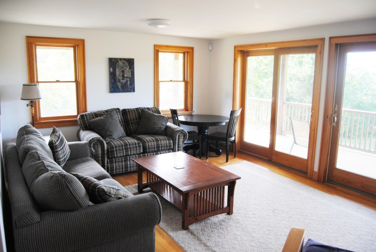 Downstairs living room with sliding doors unto the lower deck