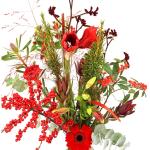 Geplukt kerstboeket rode bloemen in melkbus vaas bestellen of bezorgen