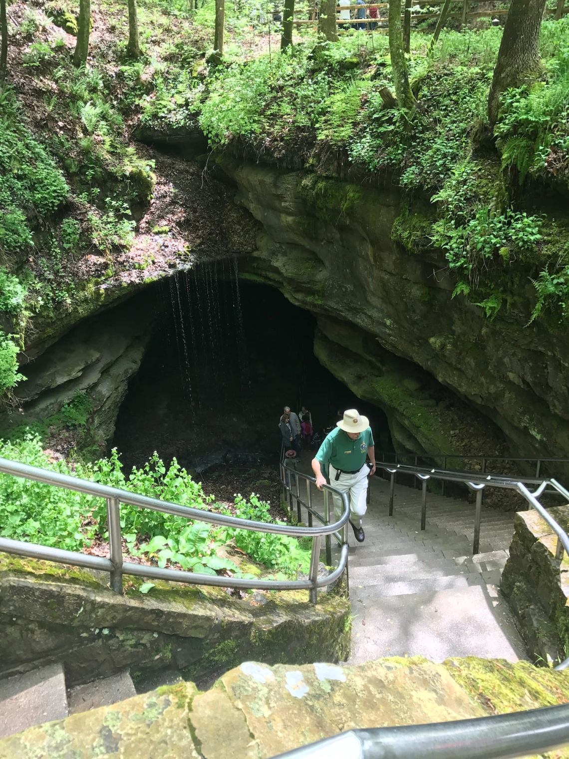 Ranger walking up the stairwell from Mammoth Cave.