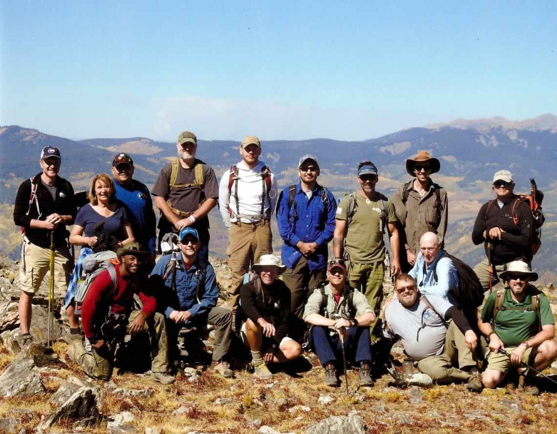 group of veterans on top of mt yeckel near aspen colorado