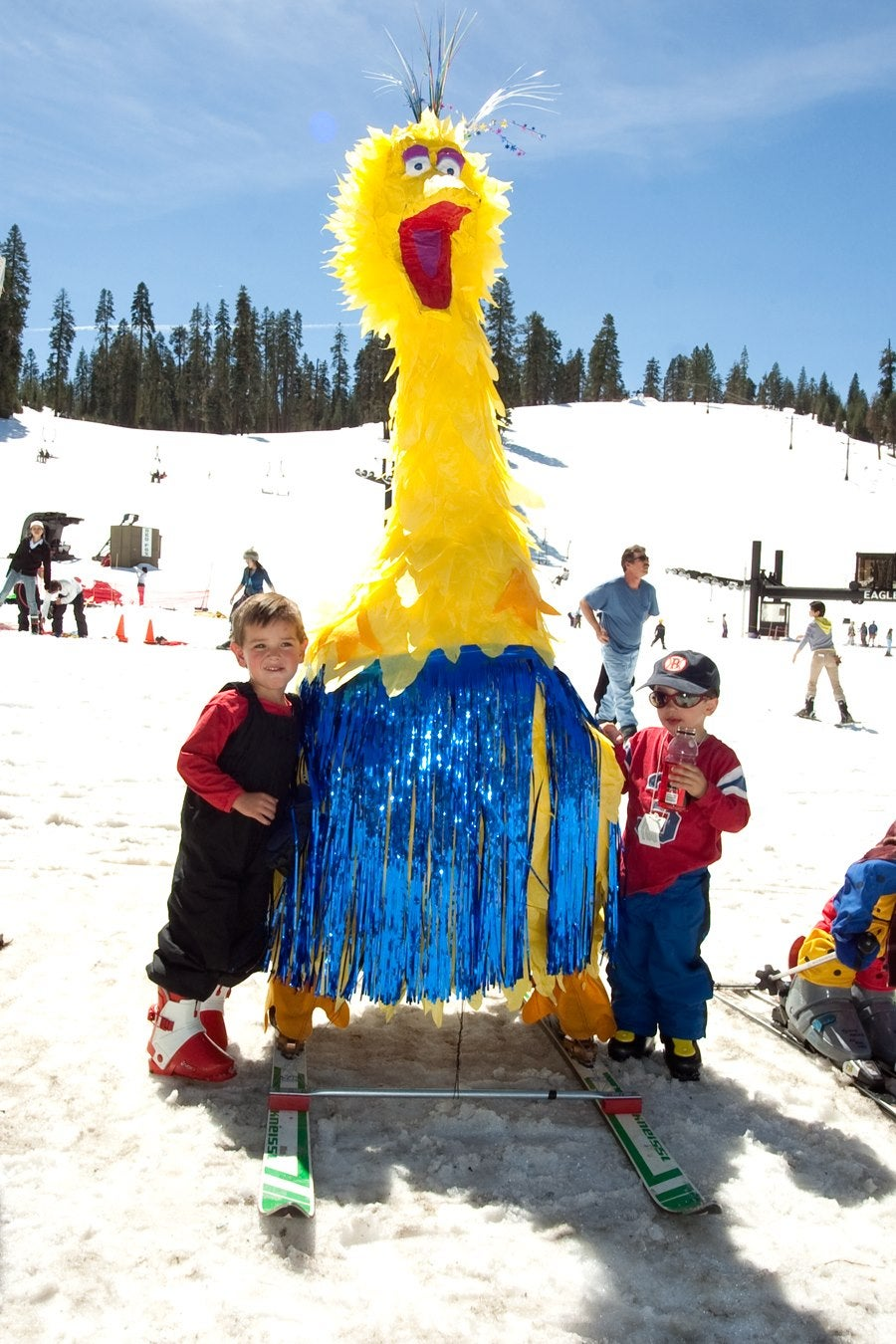 two young boys pose with big bird puppet during Springfest at Badger Pass