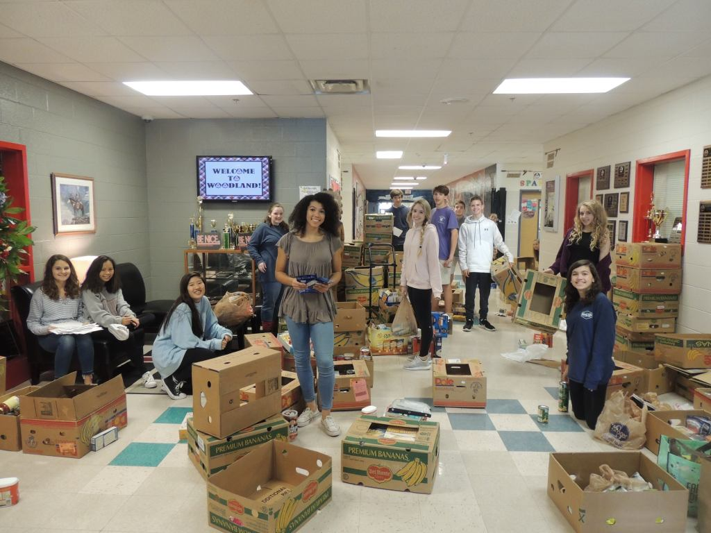 Teens work packaging food for the Jumbled Dreams nonprofit founded by Jennifer's daughter, Sydnee Floyd