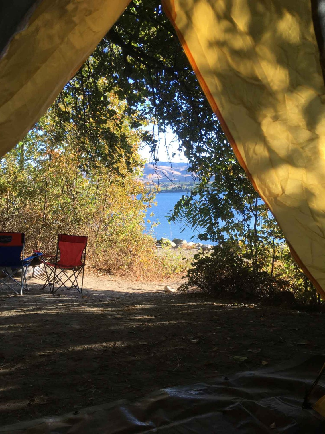 view from inside a tent at lake chelan state park in washington state
