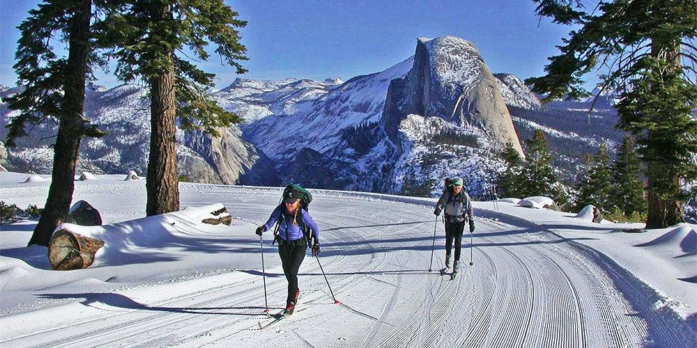 skiers outside of yosemite half dome