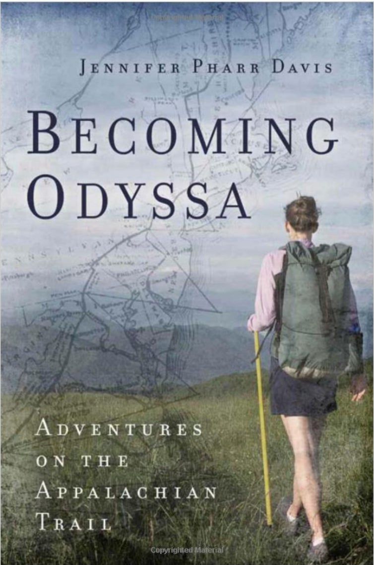 a woman hikes on grass on a book cover