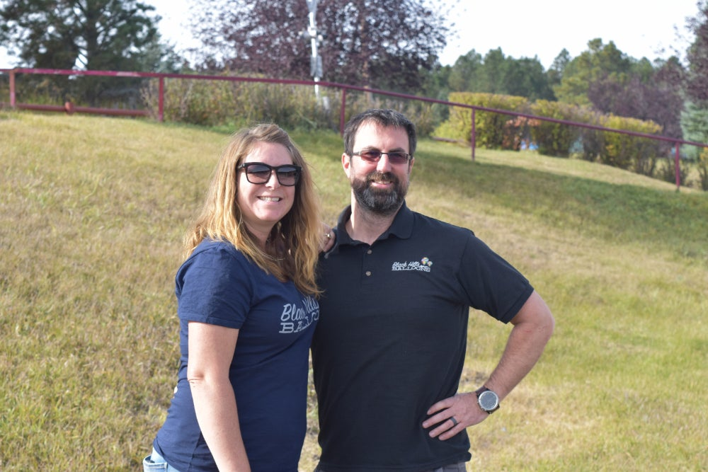 Photo of Keeley and Damien, founders of Black Hills Balloons